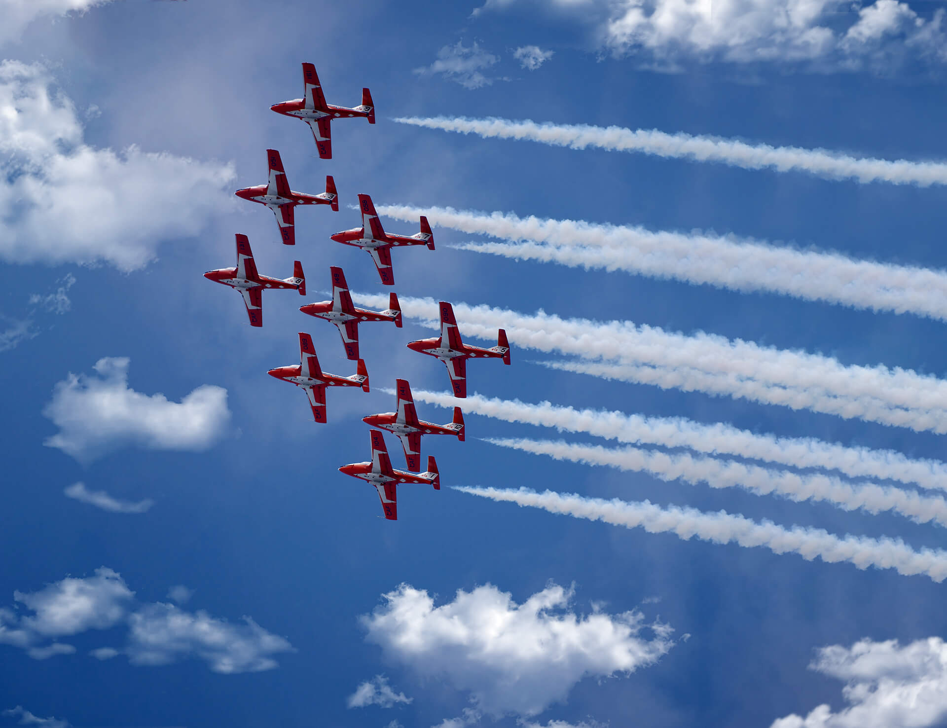 snowbirds, blue skies, in formation
